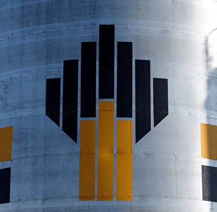 Shadow of worker is seen next to logo of Russia's Rosneft oil company at central processing facility of Rosneft-owned Priobskoye oil field outside Nefteyugansk