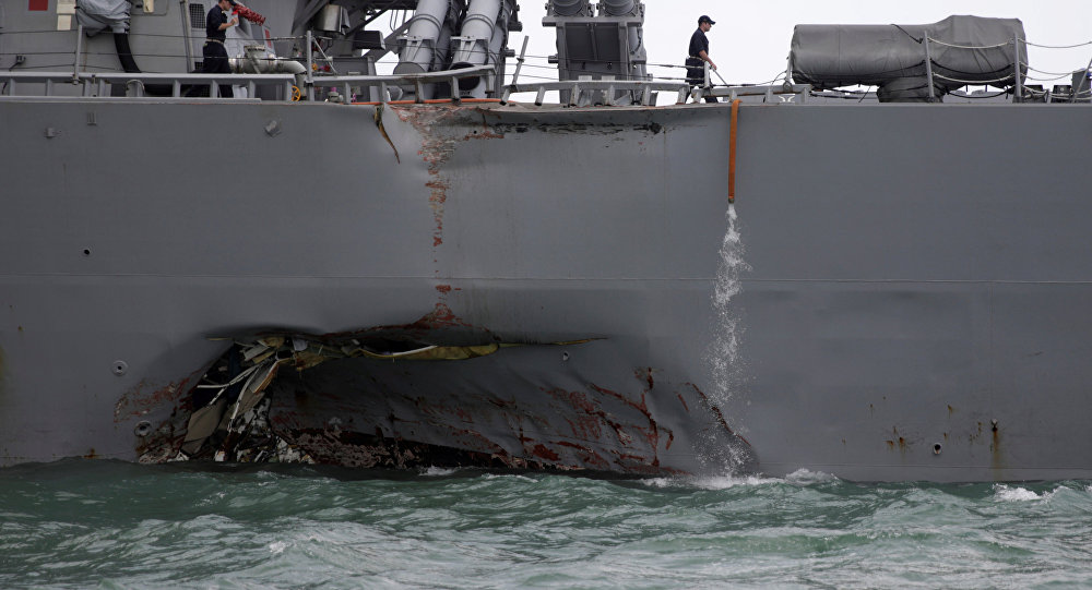 The U.S. Navy guided-missile destroyer USS John S. McCain is seen after a collision, in Singapore waters