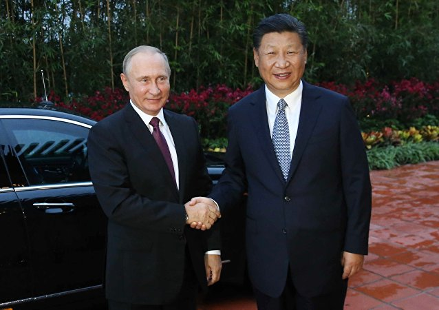 习近平:中方愿同俄方合力维护地区及世界和平稳定