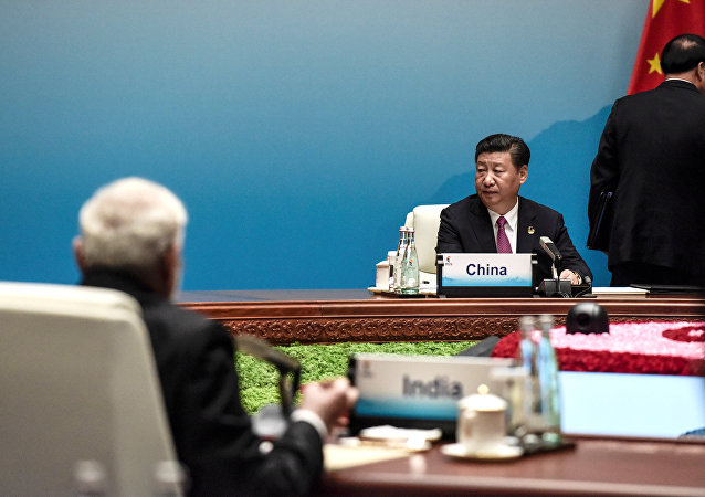 Chinese President Xi Jinping and Indian Prime Minister Narendra Modi attend the plenary session during the BRICS Business Forum the BRICS Summit in Xiamen