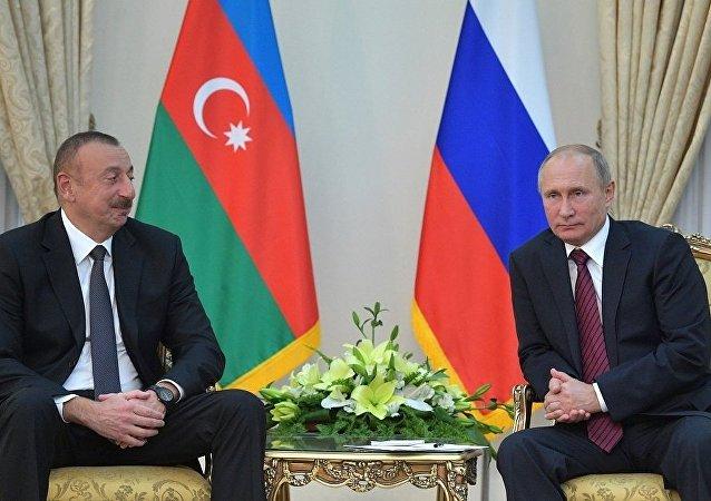 伊利哈姆·阿利耶夫和普京