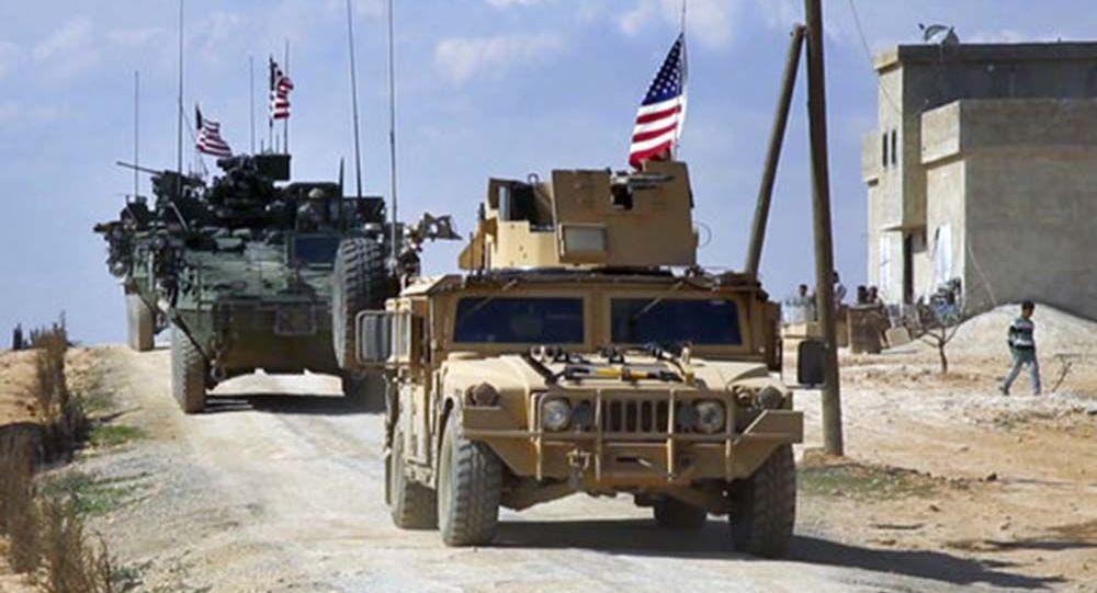 Американский патруль в сирийском городе Манбий провинции Алеппо