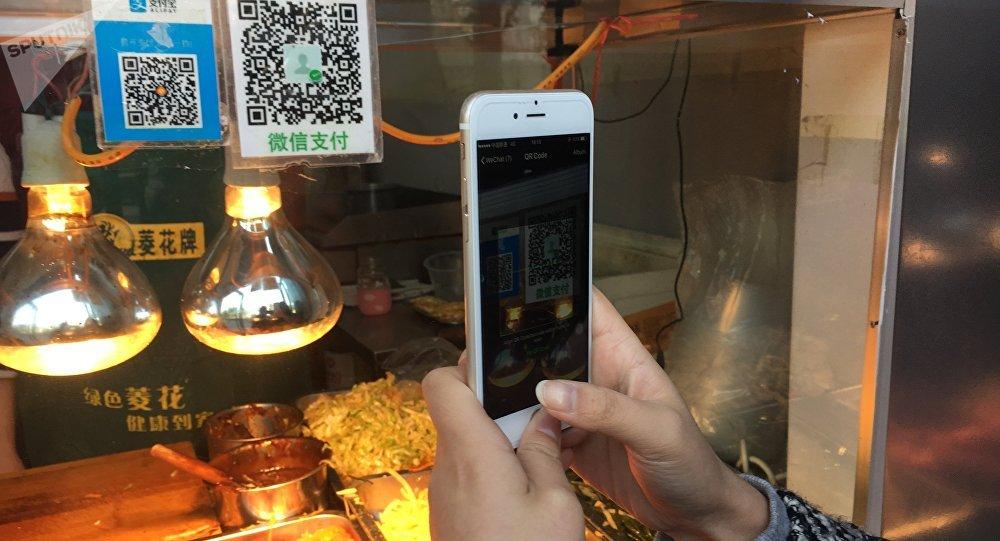 中国许多贸易摊位不再接受作为法定流通货币的人民币现金