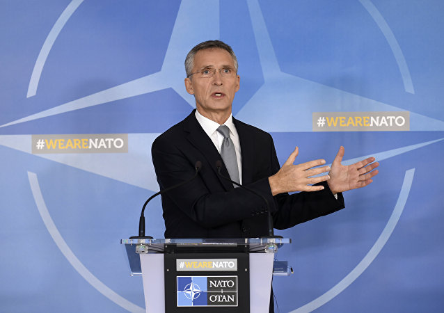 NATO Secretary General Jens Stoltenberg delivers a speech during a NATO Defence Council meeting