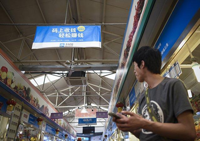 中国能否把移动支付引到国外?