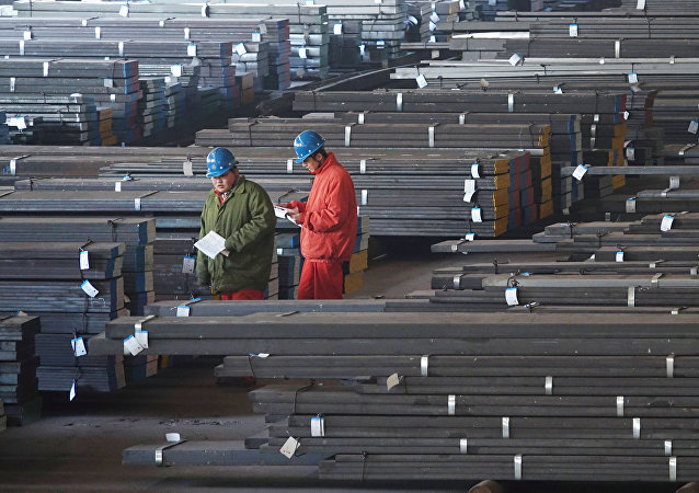 Workers check steel bars at a factory of Dongbei Special Steel Group Co., Ltd. in Dalian