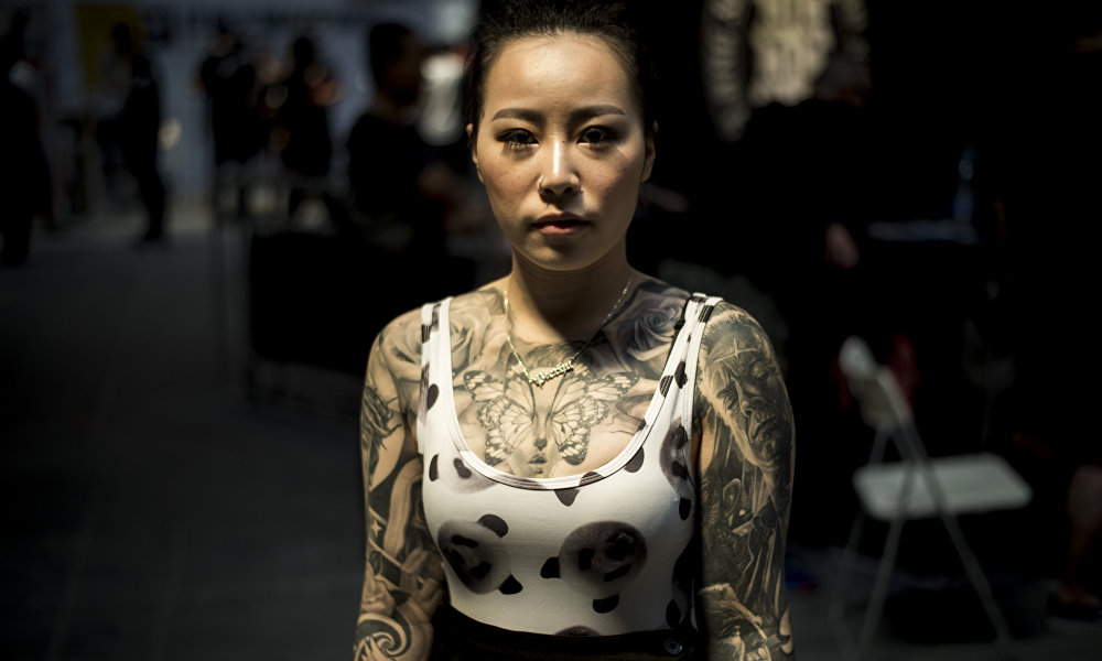 中国女性不再羞於纹身图片