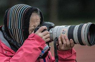 中国体坛元老级摄影师洪南丽