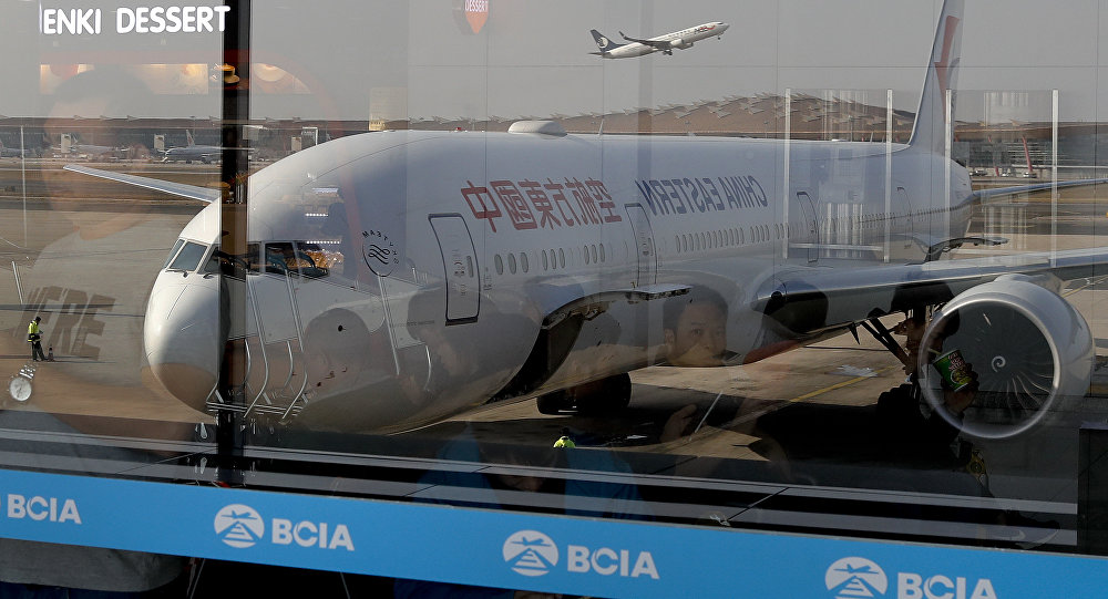 China Eastern Airlines' Boeing 777 passenger airplane through window glasses at the Beijing Capital International Airport