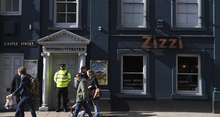 A police officer stands guard outside a branch of the Italian chain restaurant Zizzi close to The Maltings shopping centre in Salisbury