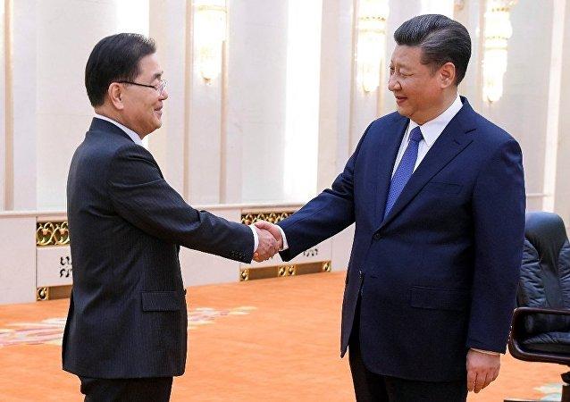 习近平会见韩总统特使郑义溶:期待朝美对话顺利举行