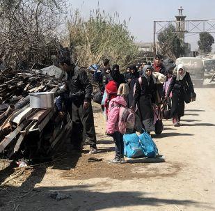 112名武装分子及其逾1000名家人离开叙杜马镇