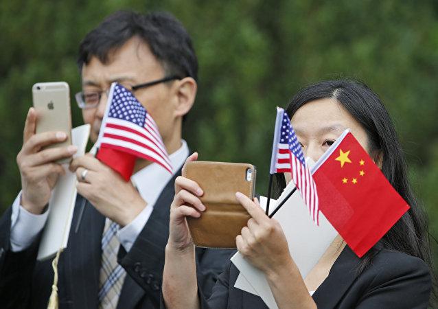 牛津经济研究所:中美贸易战对未来的世界经济影响不大