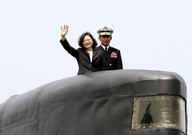 Taiwan's President Tsai Ing-wen, left, waves from a Zwaardvis-class submarine