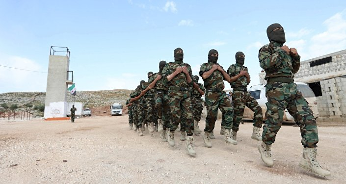 Fighters from the Jaysh al-Izza (the Army of Glory), affiliated with the Turkish-backed Free Syrian Army, take part in a training session in the northwestern Syrian city of Idlib
