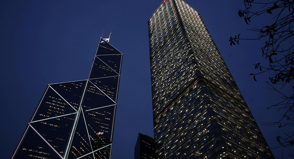 An evening view of Cheung Kong Centre and the Bank of China Tower at Hong Kong's business Central district
