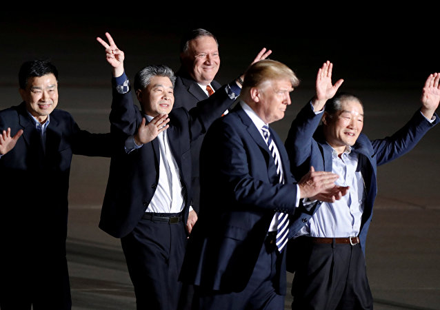 The three Americans formerly held hostage in North Korea gesture next to U.S.President Donald Trump and Secretary of State Mike Pompeo, upon their arrival at Joint Base Andrews