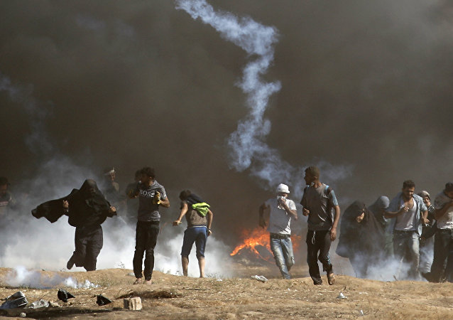 Palestinians clash with Israeli forces near the border between the Gaza strip and Israel east of Gaza City