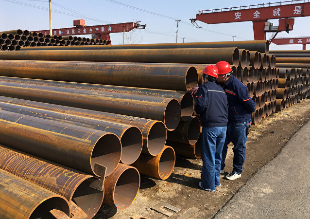 Workers inspect steel pipes at a steel mill of Hebei Huayang Steel Pipe Co Ltd in Cangzhou