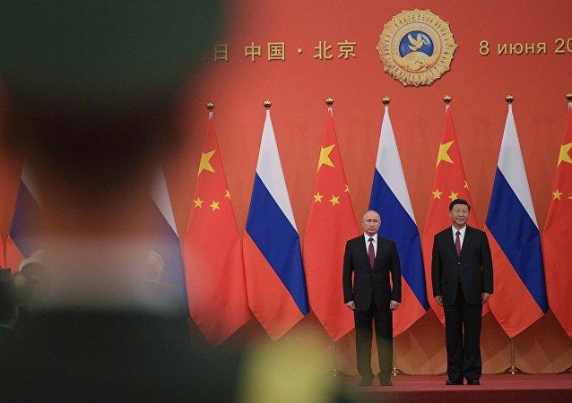 俄中领导人在普京访华期间就哪些方面达成协议