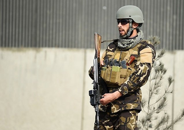 An Afghan security personnel