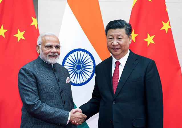 Chinese President Xi Jinping, right, meets with Indian Prime Minister Narendra Modi