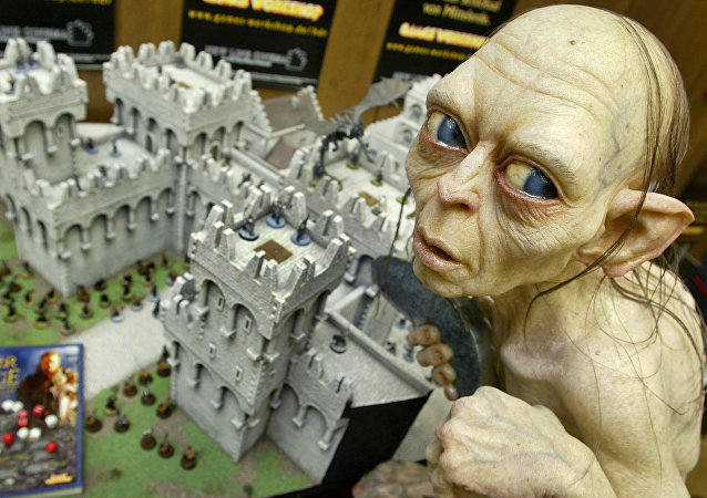 Gollum, a character from the Lord of the Rings tale, sits above a model of the town Minas Tirith