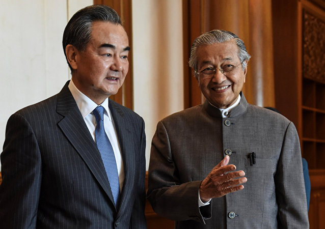 China's Foreign Minister Wang Yi meets with Malaysia's Prime Minister Mahathir Mohamad