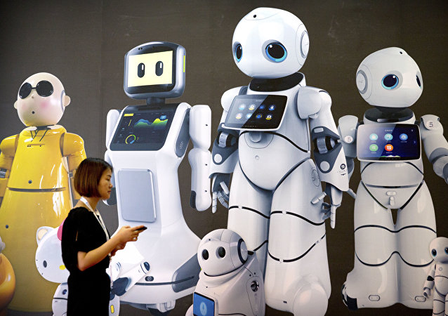 A visitor walks past a mural displaying robots from Chinese robot maker Canbot at the World Robot Conference in Beijing