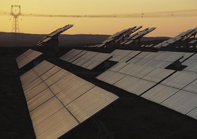A solar power farm is seen along a highway in the northwestern China's Ningxia Hui autonomous region