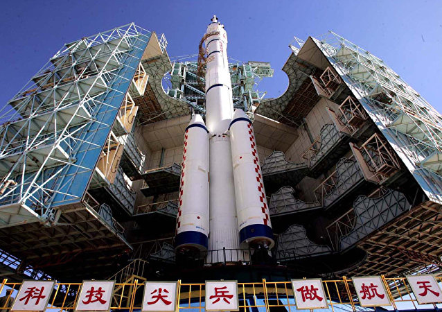 China's second manned spacecraft Shenzhou-6 joined by the Long March CZ-2F rocket at the launch tower of the Jiuquan Satellite Launch Center