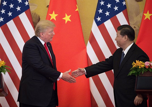 US President Donald Trump (L) shakes hands with China's President Xi Jinping at the end of a press conference at the Great Hall of the People in Beijing on November 9, 2017. Donald Trump urged Chinese leader Xi Jinping to work hard and act fast to help resolve the North Korean nuclear crisis, during their meeting in Beijing Thursday, warning that time is quickly running out.