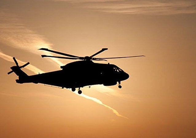 媒体:一枚导弹击中阿富汗南部一架军用直升机 四人受伤