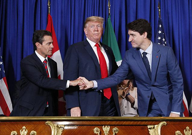 Президент США Дональд Трамп, уходящий глава Мексики Энрике Пенья Ньето и премьер-министр Канады Джастин Трюдо