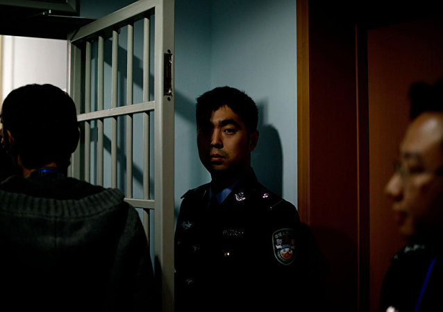 Охрана в центре для заключенных в Пекине. Архивное фото.
