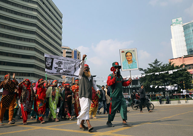 Supporters of the ruling party Bangladesh Awami League hold a picture of the Prime Minister Sheikh Hasina as they join in a campaign ahead of the 11th general election in Dhaka.