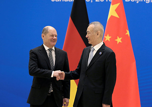 Olaf Scholz shakes hands with China's Vice Premier Liu He
