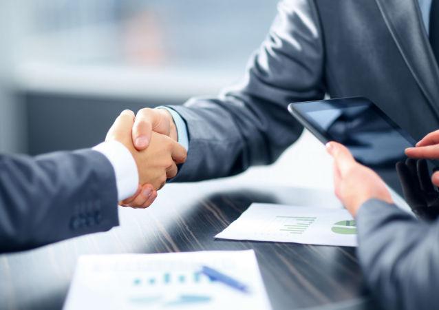 Рукопожатие деловых людей