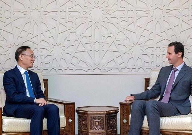 叙利亚总统阿萨德和中国外长助理陈晓东(资料图片)