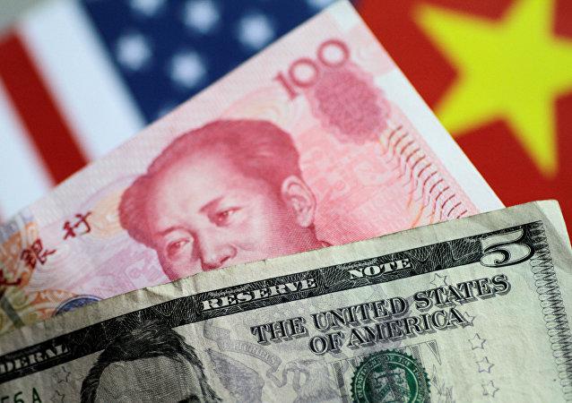 """中国央行:人民币汇率""""破7""""是市场供求和国际汇市波动的反映"""