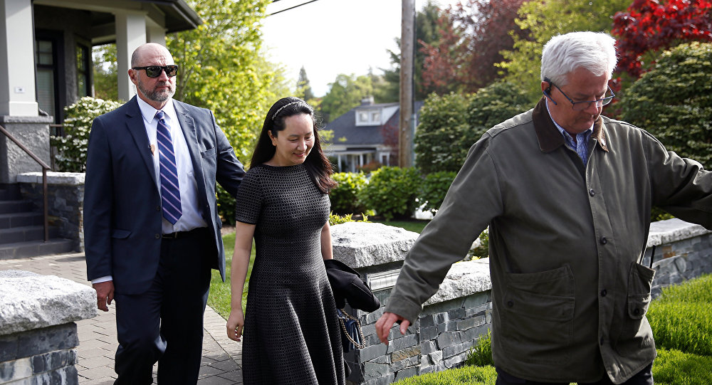 Huawei's Financial Chief Meng Wanzhou leaves her family home flanked by private security in Vancouver, British Columbia