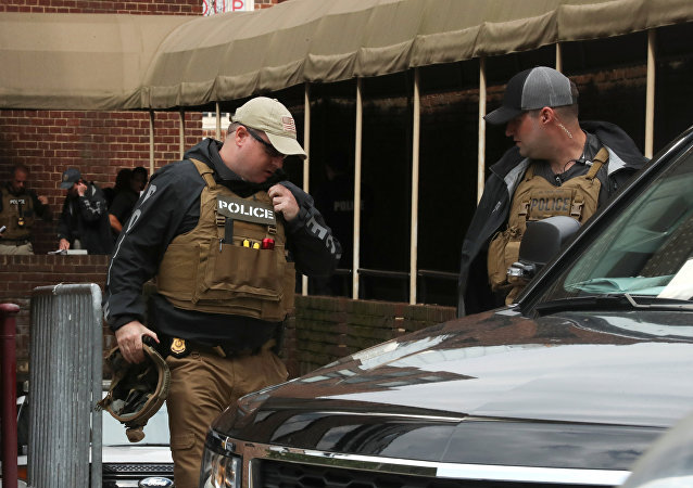 Police take positions outside the Venezuelan embassy where several activists remained holed up in Washington