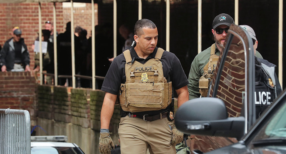 Police take positions outside the Venezuelan embassy where activists remained holed up in Washington