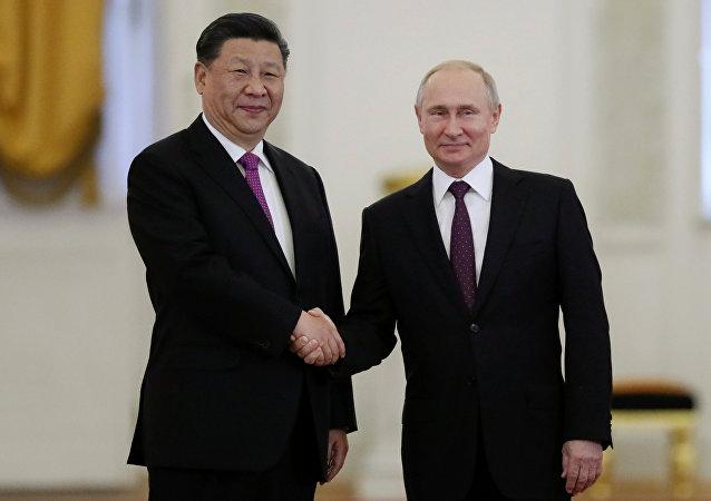 习近平致电普京表示中国将同俄罗斯一道捍卫二战成果