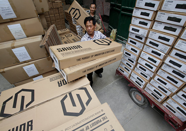 Workers load boxes of gun cases for a U.S. client in a factory of firearm equipment manufacturer Yakeda Tactical Gear Co, which exports most of its products to the United States, in Guangzhou
