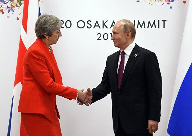 俄罗斯总统普京与英首相梅