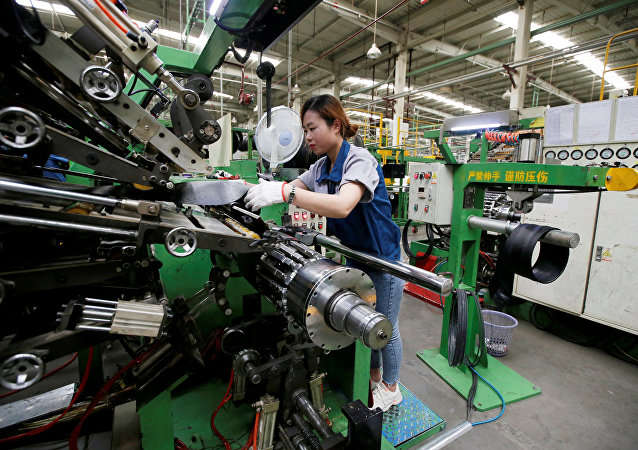 An employee works on the production line of a tyre factory under Tianjin Wanda Tyre Group in Xingtai