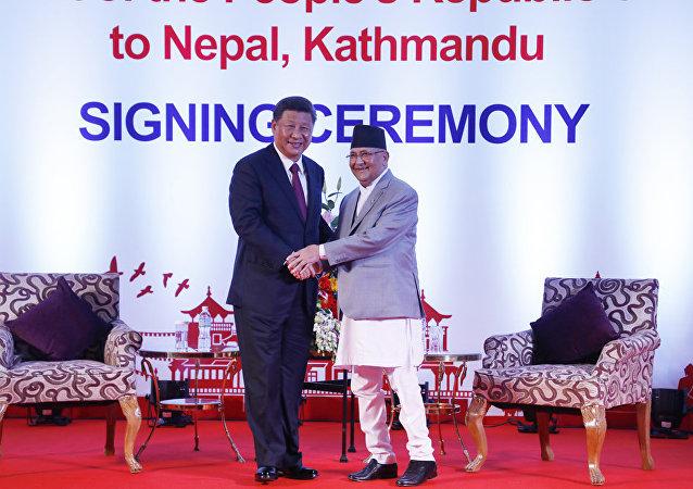 中国国家主席习近平13日在加德满都同尼泊尔总理奥利会谈