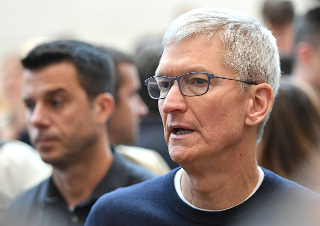 In this file photo taken on September 10, 2019 Apple CEO Tim Cook speaks with attendees during an Apple product launch event at Apple's headquarters in Cupertino, California.
