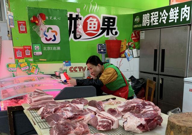 外媒:中国增加从美国进口大豆和猪肉